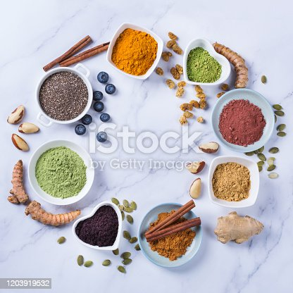 1005962360 istock photo Assortment of superfood powder, acai, turmeric, ginger, matcha, cinnamon, wheat 1203919532