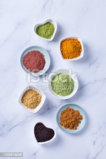 1005962360 istock photo Assortment of superfood powder, acai, turmeric, ginger, matcha, cinnamon, wheat 1203919536