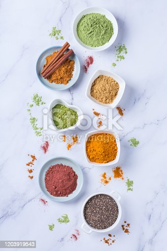 1005962360 istock photo Assortment of superfood powder, acai, turmeric, ginger, matcha, cinnamon, wheat 1203919543