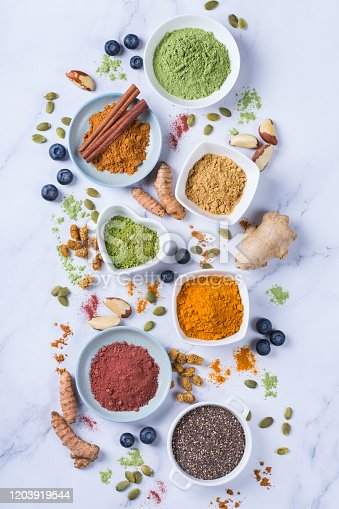 1005962360 istock photo Assortment of superfood powder, acai, turmeric, ginger, matcha, cinnamon, wheat 1203919544