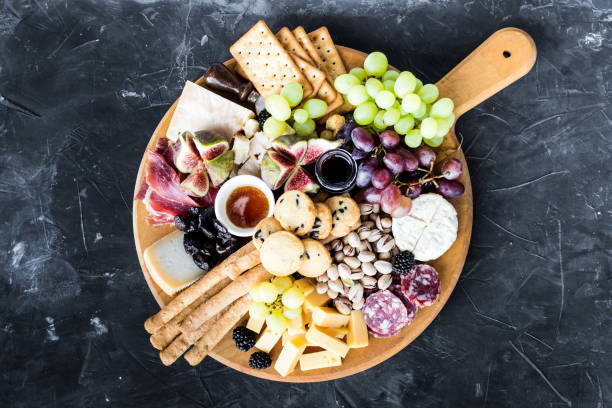 Assortment of tasty appetizers or antipasti stock photo
