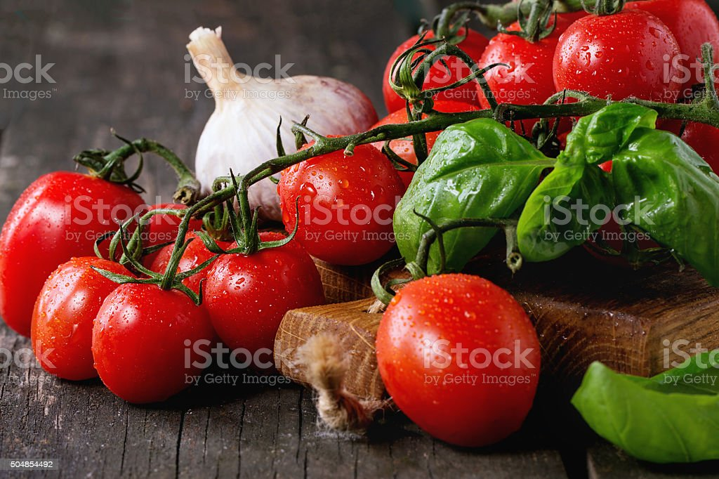 Assortment of tomatoes and vegetables stock photo