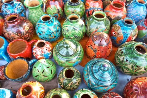 Assortment of Traditional Costa Rica Porcelain Pottery and Crafts sold as Colorful Handicraft Tourist Souvenirs in outdoor market near the Entrance to Manuel Antonio National Park stock photo