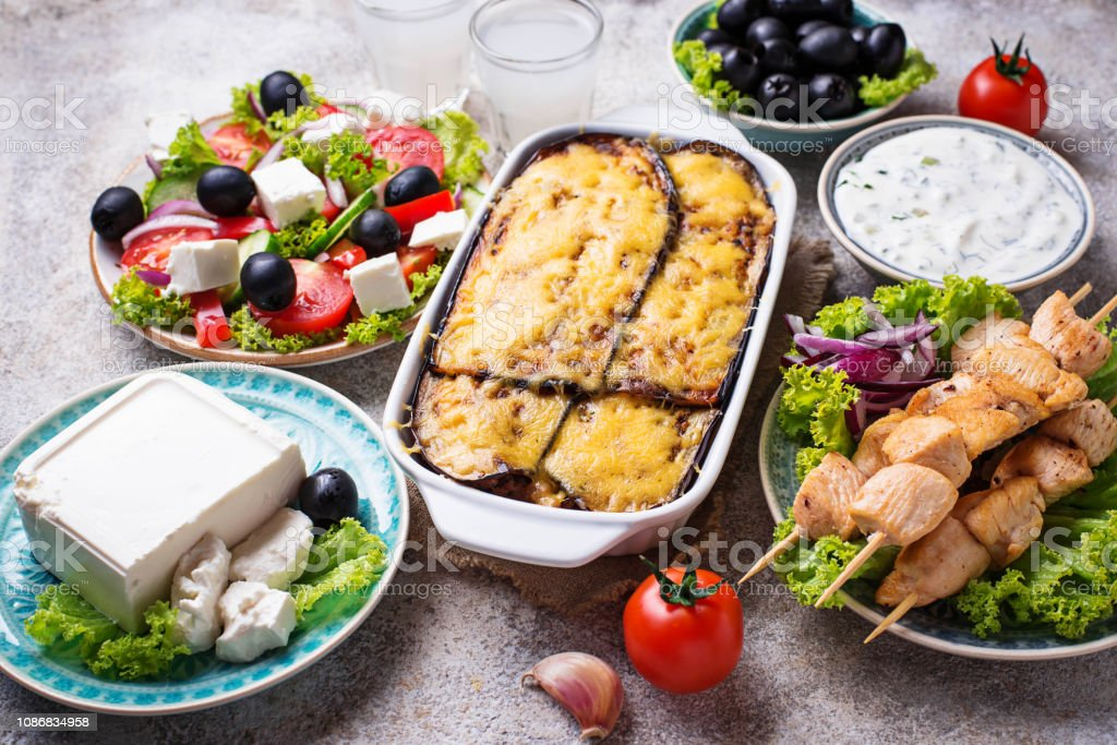 Assortment of traditional greek dishes. Salad, tzatziki, feta, meze,...