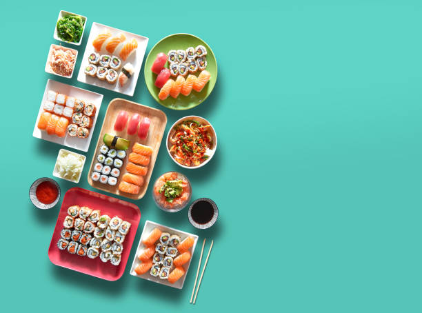 Assortment of trays and plate of sushi and maki stock photo