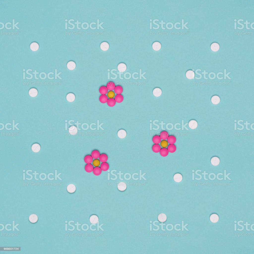 Assortment of various colourful pills on pastel coloured background. Medication and prescription pills flat lay background. stock photo