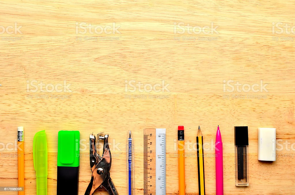 Assortment of various school items on wooden background stock photo