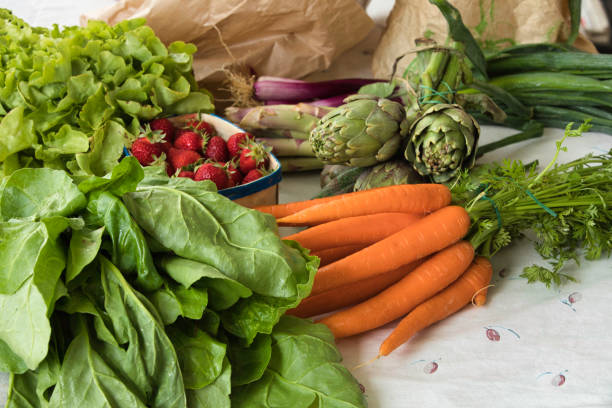 Assortment of vegetables placed on a table. stock photo