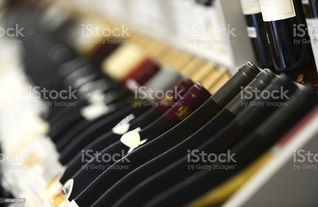 Assortment of Wines on Wine Rack - Shallow Focus stock photo