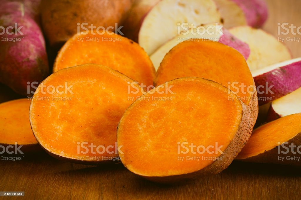 Assortment of Yellow and White Fleshed yams or Sweet Potatoes stock photo