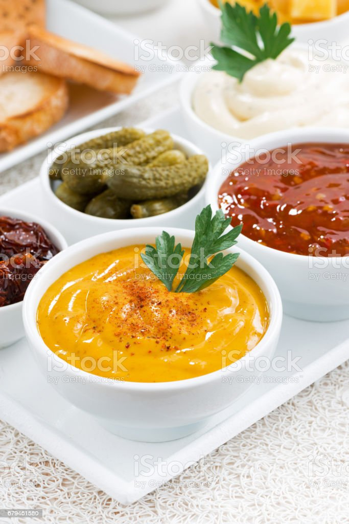 assortment sauces and snacks, vertical, closeup royalty-free stock photo