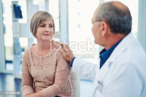 Shot of a male doctor seeing a patient in his office