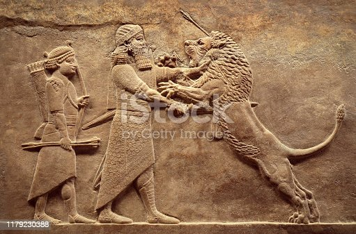 istock Assyrian wall relief, detail of panorama with royal lion hunt 1179230388