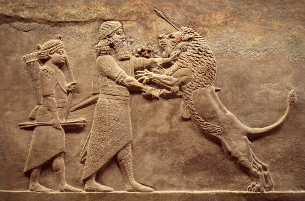 Assyrian wall relief, detail of panorama with royal lion hunt stock photo