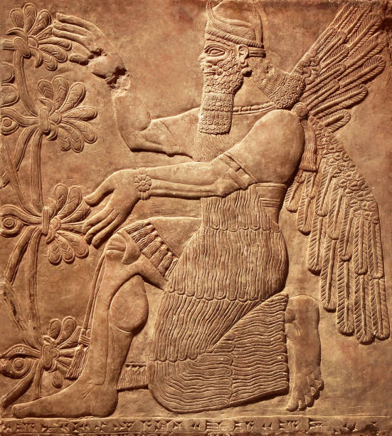 Assyrian wall relief of a winged genius stock photo