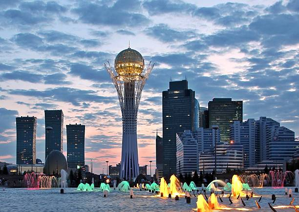 Astana cityscape New centre of Astana capital city of Kazakhstan with landmark Baiterek tower at sunset kazakhstan stock pictures, royalty-free photos & images