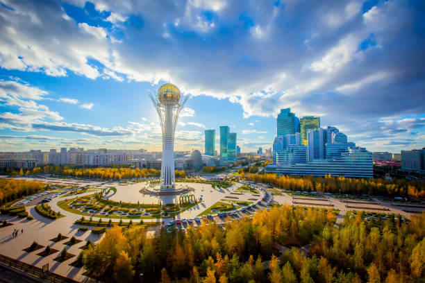 Astana, Nur-Sultan, Kazakhstan. Center of the city, skyscraper, view on Baiterek Golden autumn in the capital of Kazakhstan. Modern buildings and blue sky. kazakhstan stock pictures, royalty-free photos & images
