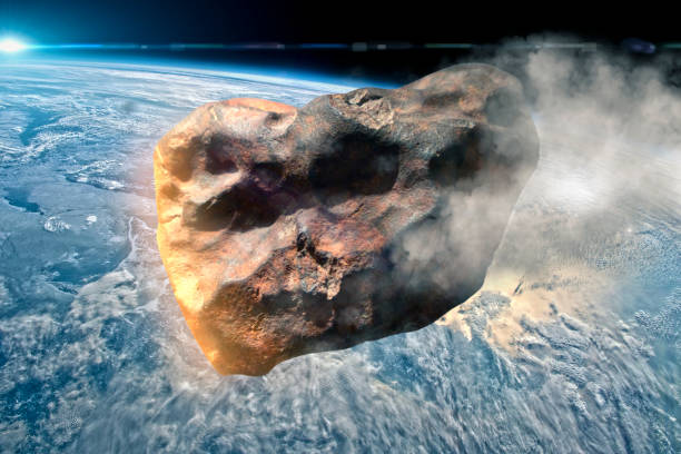 asteroid approaches the earth stock photo