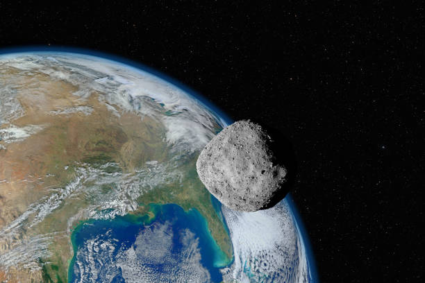 Asteroid approaching planet Earth, elements of this image furnished by NASA stock photo