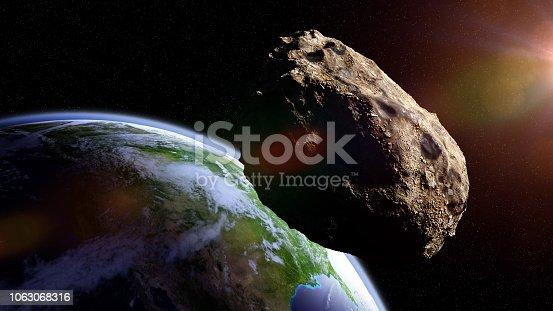 istock asteroid approaching planet Earth, meteorite in orbit before impact 1063068316