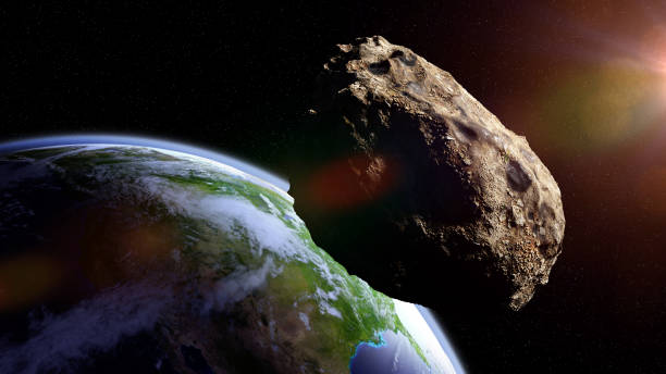 asteroid approaching planet Earth, meteorite in orbit before impact stock photo
