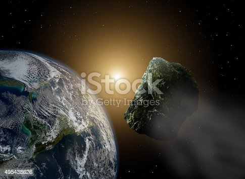Asteroid in space near earth in sunlight