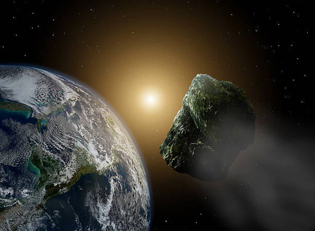 Asteroid in space near earth in sunlight stock photo