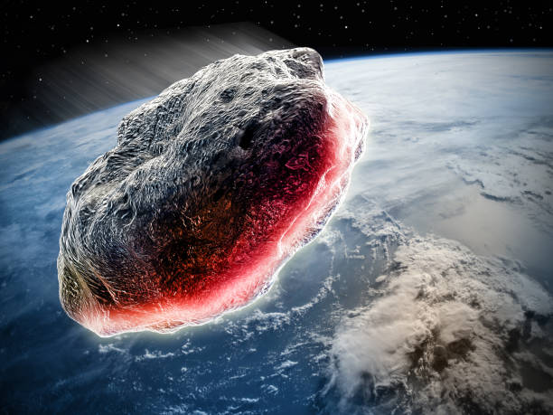 Asteroid moving trough the earth stock photo
