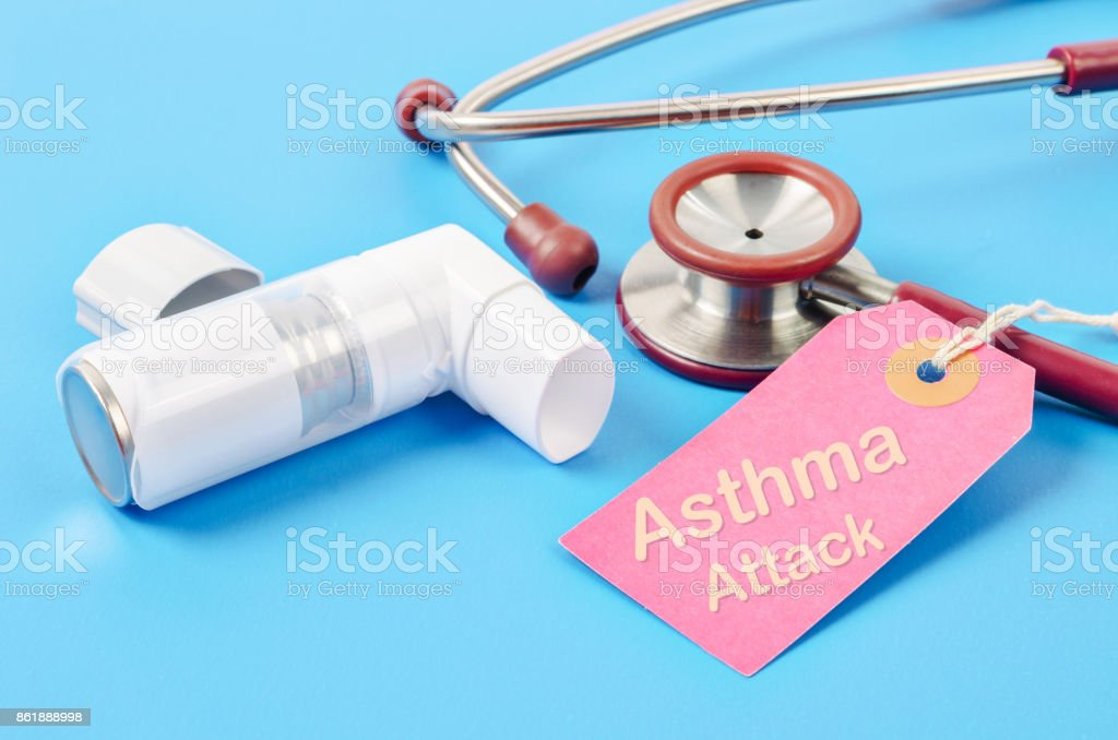 Asthma attack tag with asthma inhaler with stethoscope medical stock photo
