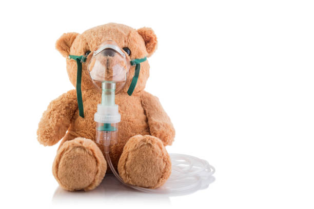 Asthma control Teddy Bear controlling his asthma. respiratory disease stock pictures, royalty-free photos & images