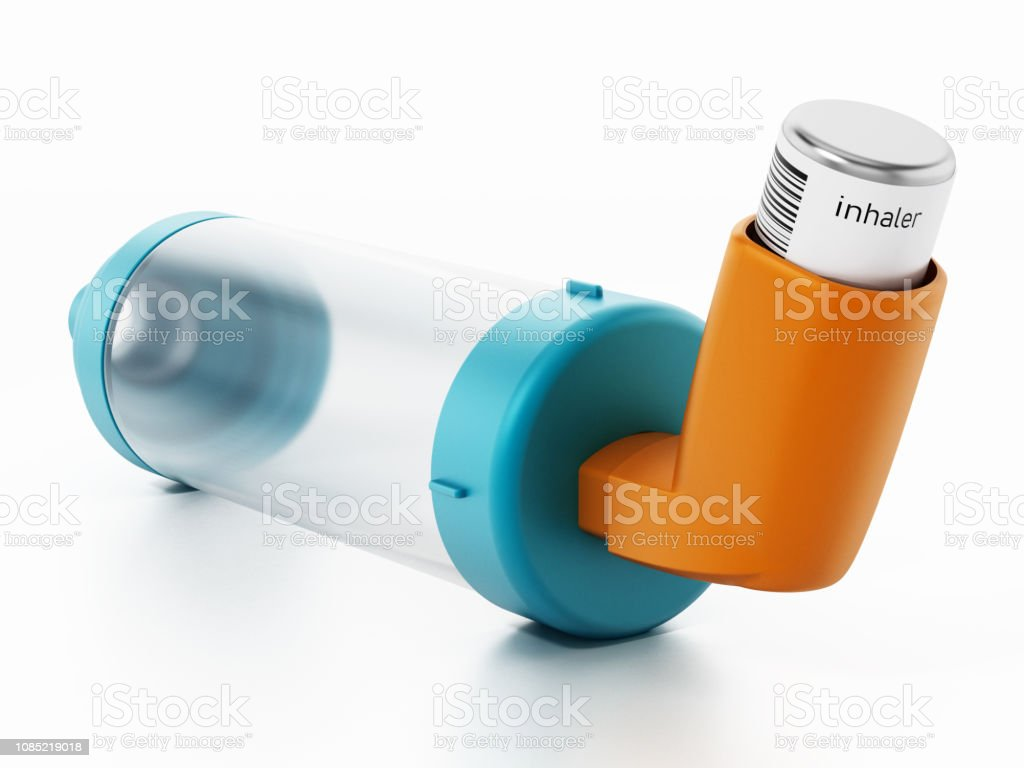 Asthma inhaler and air chamber stock photo