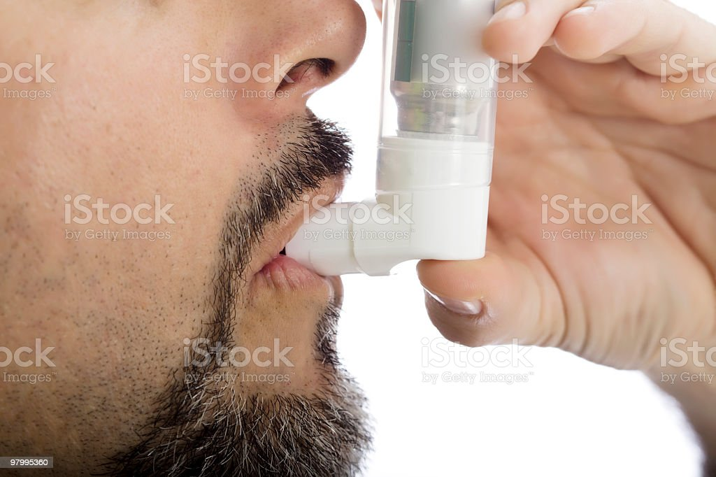 Asthma Inhaler Being Used royalty-free stock photo