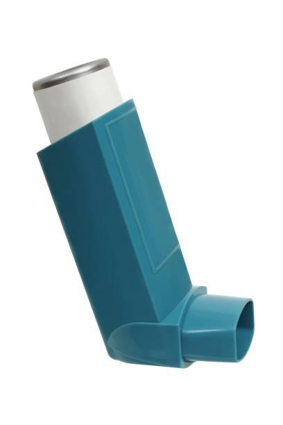 Asthma inhaler on white stock photo