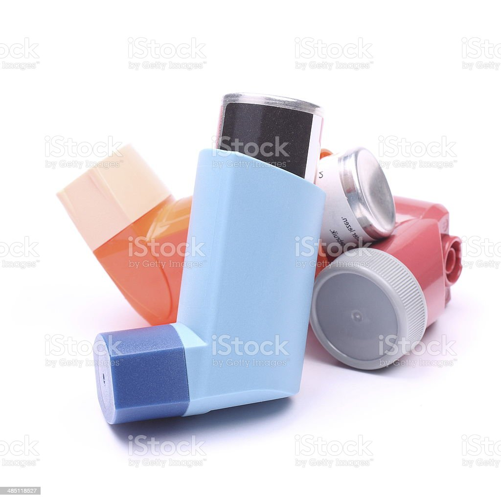 Asthma inhalers isolated over white stock photo