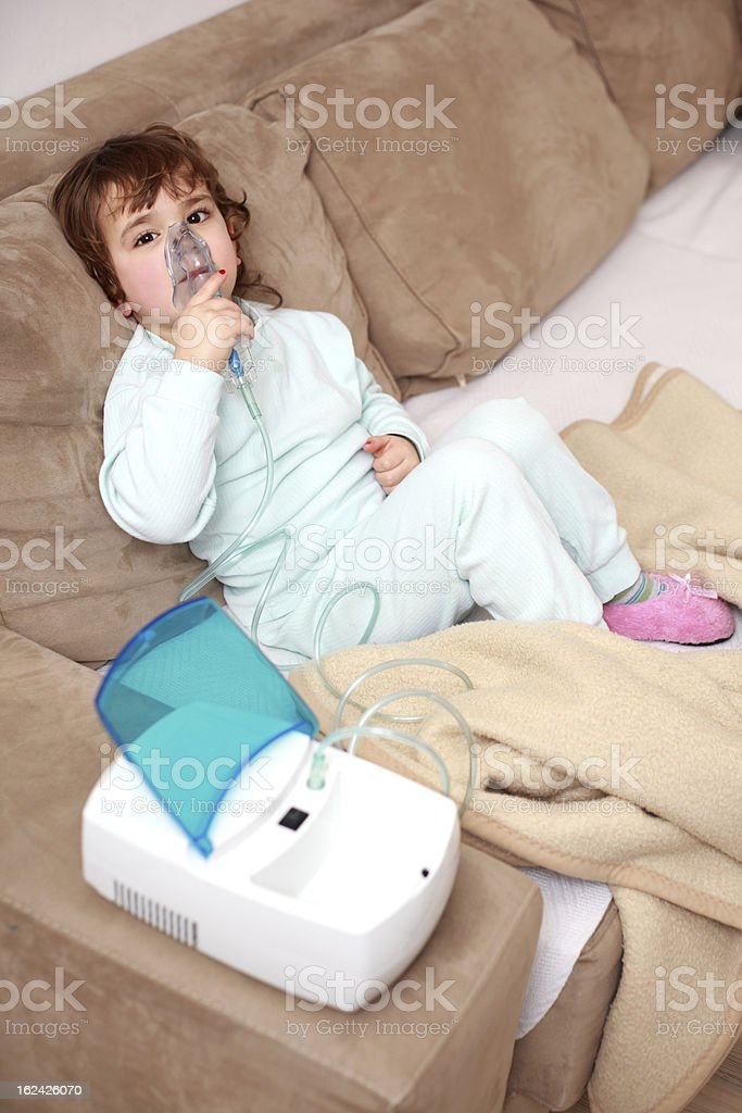 Asthma, little girl with inhaling mask royalty-free stock photo