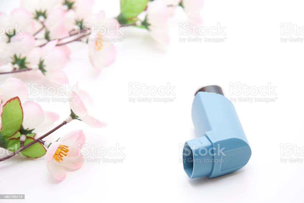 Asthma spray with flowering branch royalty-free stock photo