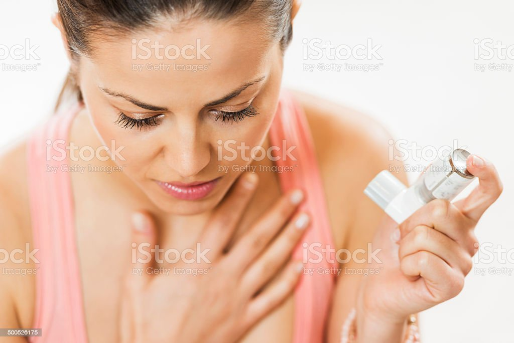 Asthmatic woman. stock photo