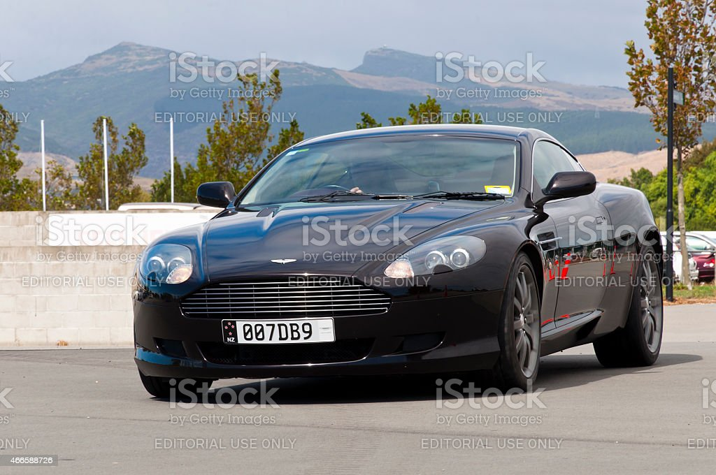 Aston Martin DB9 from 2005. Christchurch,New Zealand - Mars 08,2015: Car enthusiast driving a  fully restored Aston Martin DB9 from 2005 in a classic car cavalcade the Twin Rivers Car Parade. The car parade is held every year in Christchurch in New Zealand . Antique Stock Photo