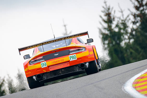 Aston Martin Racing Aston Martin Vantage V8 race car Spa, Belgium - May 2, 2015: Aston Martin Racing Aston Martin Vantage V8 LMGTE racing car  driving around the Spa Francorchamps race track during the WEC 6 Hours of Spa-Francorchamps. The car participates in the 2015 FIA World Endurance Championship (WEC) won the LMGTE Pro class at Spa. spa belgium stock pictures, royalty-free photos & images
