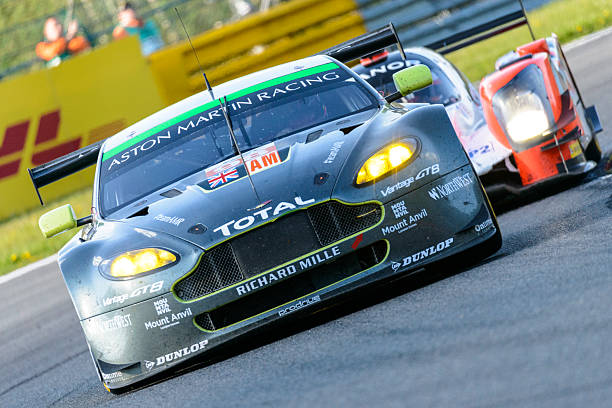 Aston Martin Racing Aston Martin Vantage V8 race car Spa, Belgium - May 7, 2016: Aston Martin Racing Aston Martin Vantage V8 driving through Les Combes. The number 98 Aston Martin won the LMGTE AM class during the 2016 6 Hours of Spa-Francorchamps. The car is driving around the Spa Francorchamps race track during the WEC 6 Hours of Spa-Francorchamps. The team participates in the 2016 FIA World Endurance Championship (WEC). spa belgium stock pictures, royalty-free photos & images
