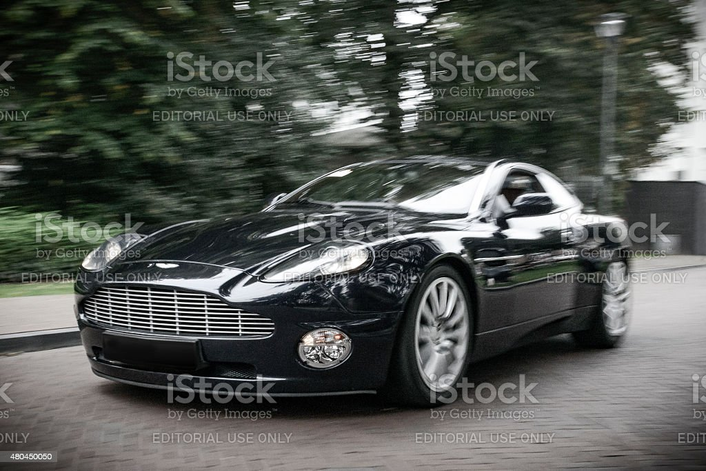Aston Martin Vanquish sports car driving fast stock photo