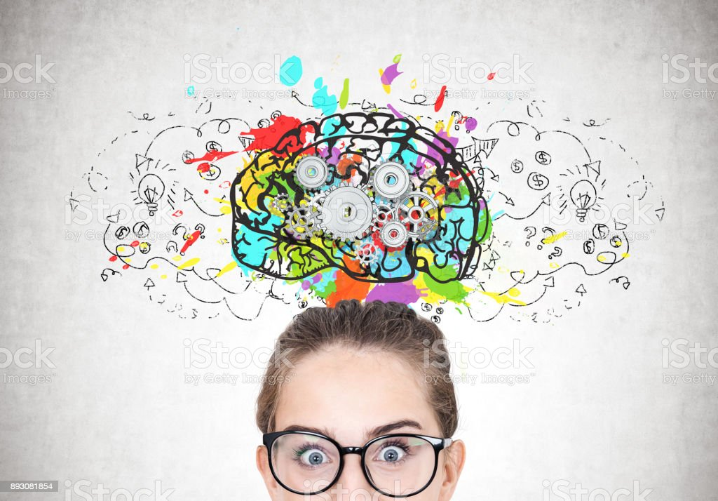 Astonished girl in round glasses, brain cogs stock photo