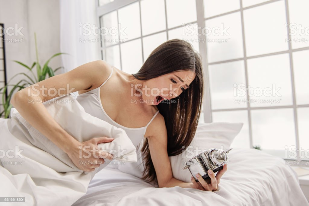 Astonishing female watching at snooze - foto de acervo