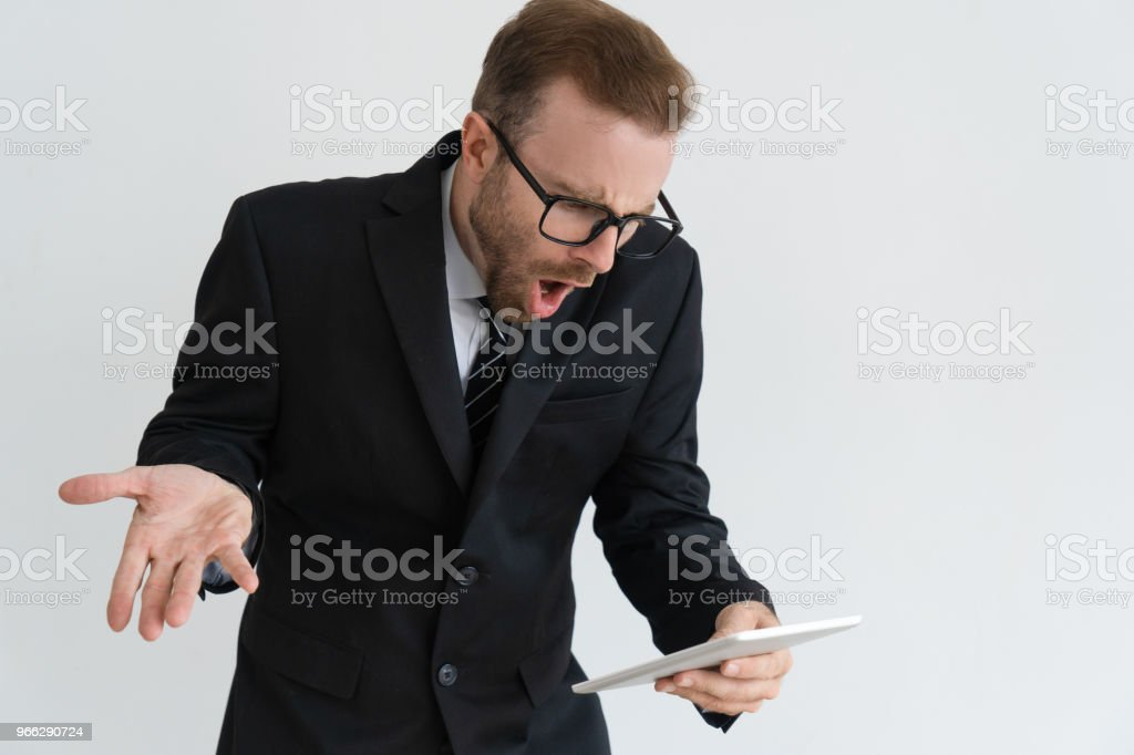 Astounded business leader checking email stock photo