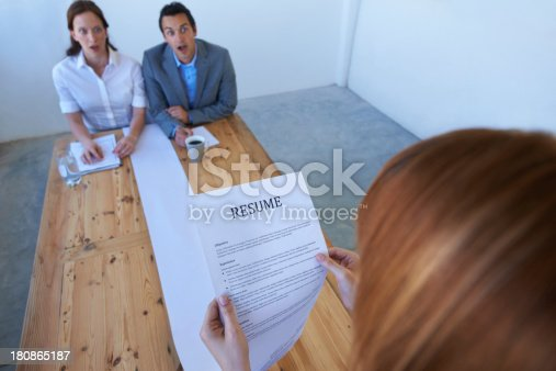 Two employers astounded by the long resume a candidate has brought in to an interview