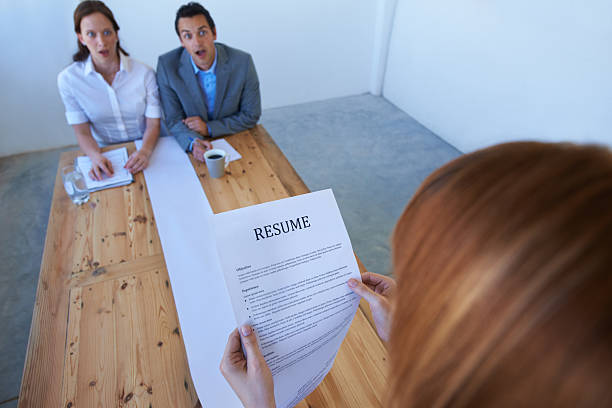 Astounded by her resume! stock photo