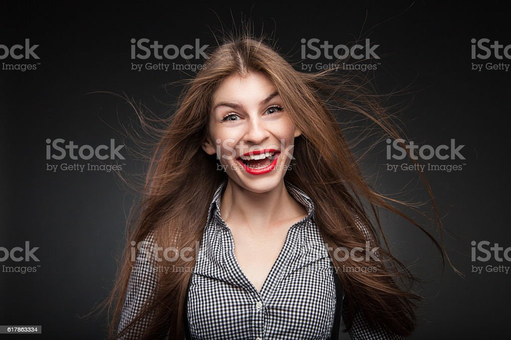 Astounded girl looking at camera. stock photo