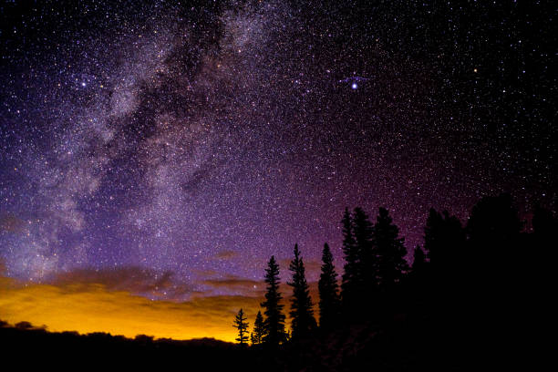 Astro Landscape with Stars and Milky Way Galaxy stock photo
