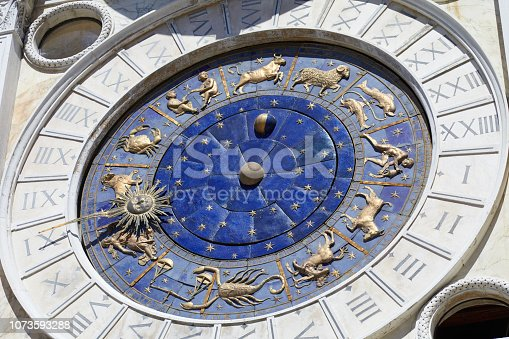 istock Astrological clock with gold zodiac signs in a sunny day 1073593288