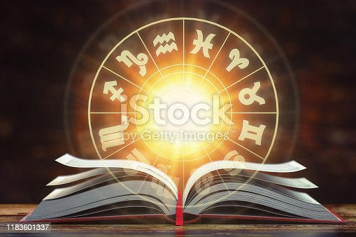 istock Astrology horoscope concept. Opened  book with magic zodiac signs and symbols. 1183601337